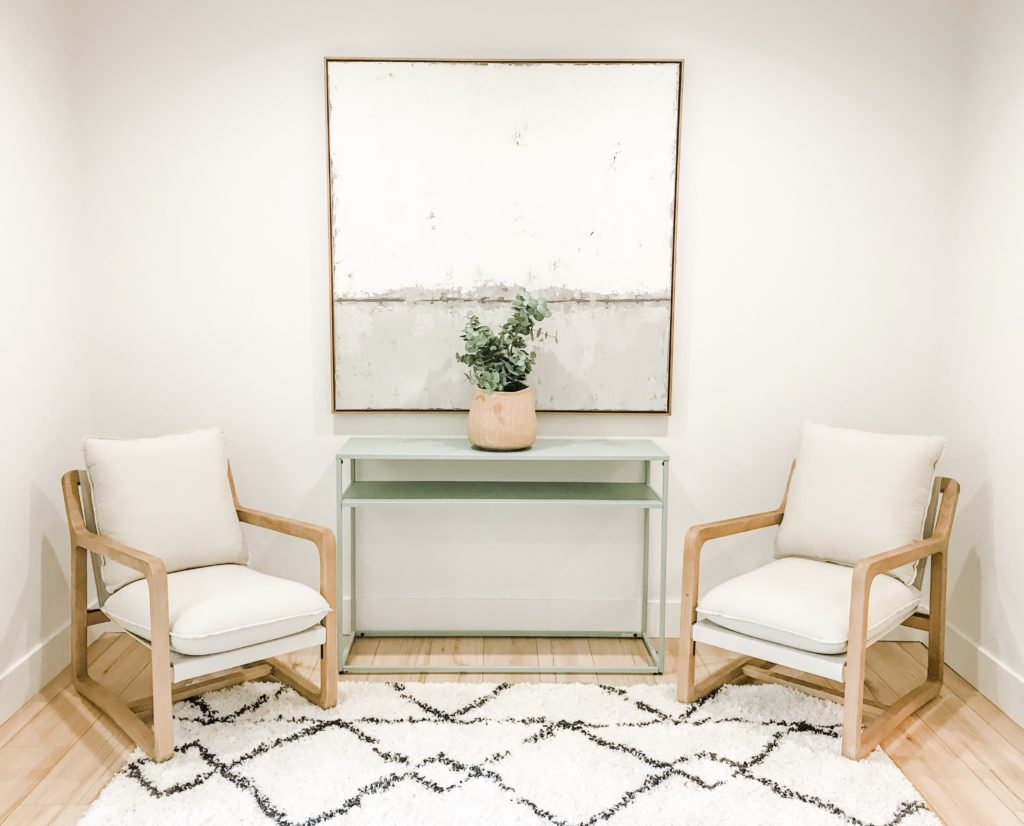 target chairs and custom art in master sitting area